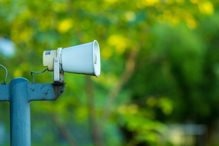 Speaker or loudspeaker or megaphone in the public park. Stock Photo