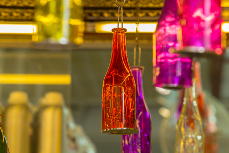 ceiling light: Beautiful colorful bottle hanging on the ceiling.