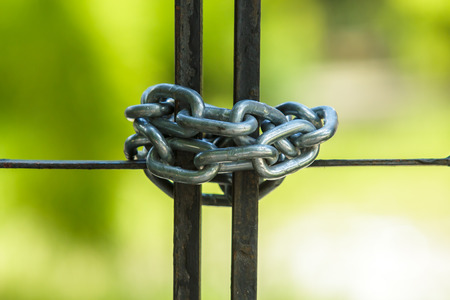 locked up in a cage: Chain lock the gate.