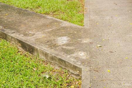crossway: Junction of walking path in garden with green grass.