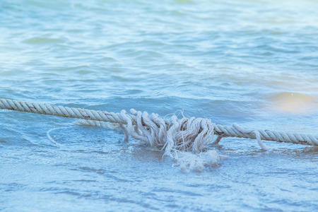 Robe: White Robe of Anchor on the beach. Stock Photo
