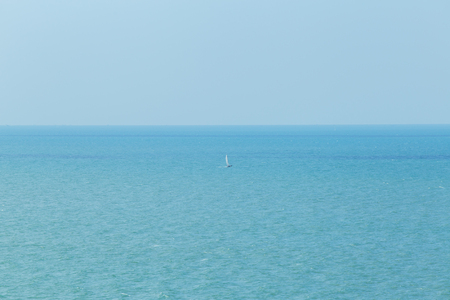 Single or alone sailboat in the big sea.