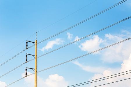 power pole: A power pole with blue sky.