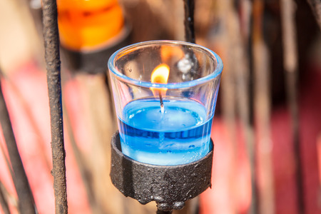scented: Beautiful colorful blue scented candles in glass. Stock Photo