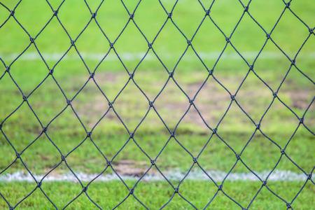goal keeper: net behind goal keeper gate. Stock Photo