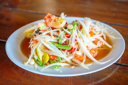 somtum: Famous Thai food, papaya salad or SOM TAM or Somtum. Stock Photo