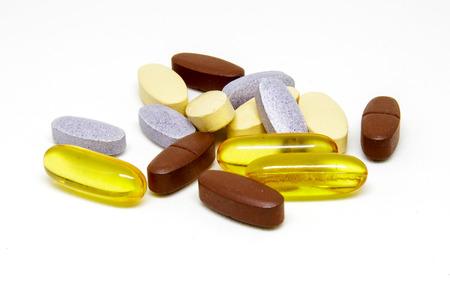 multivitamin: Multivitamin tablets on white background.