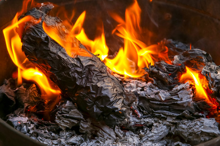 Burning paper silver and gold in Chinese new year and festivals for memory of ancestors passed away. Stock Photo
