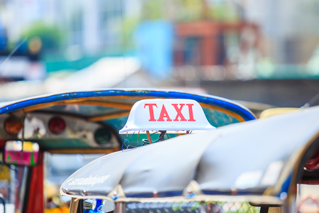 tuktuk: Closeup to banner of taxi tuktuk Bangkok, Thailand.