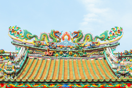 naga china: Two dragon sculpture Chinese style in the roof of Chinese temple.