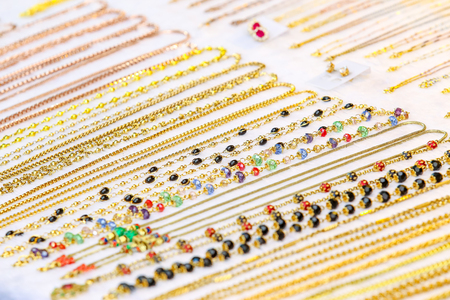 womanlike: Colorful necklace on the white table at the Thailand market. Stock Photo