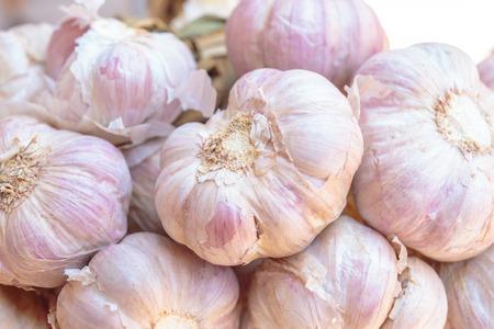 garlic clove: Closeup to garlic clove, garlic bulb.