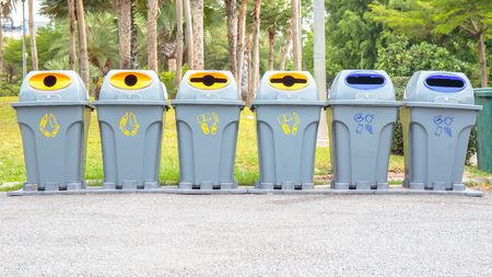 bins: Recycling bins in the public park.