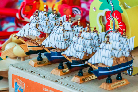 ship with gift: Suphanburi, Thailand - 20 February 2016: Vintage small sail boat or ship at market.