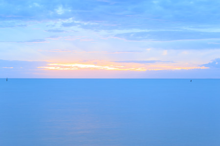 sunset at sea or ocean, with quiet feel or blue tone, sea landscape. Stock Photo