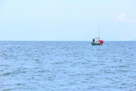 alone fishing boat in sea or ocean