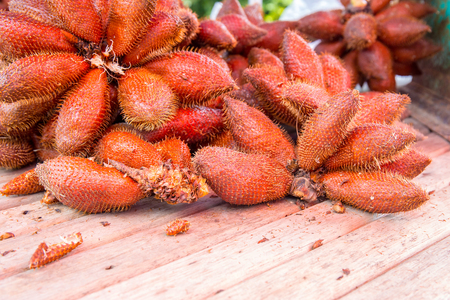 red sala fruit on wooden table