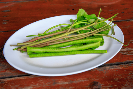 Vegetable for Famous Thai food, papaya salad or SOM TAM or Somtum. on wooden table.