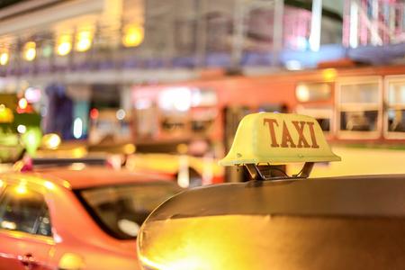 Closeup to taxi sign on the street of Bangkok, Thailand. Stock Photo