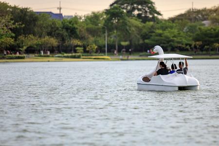 Bangkok, Thailand. - April 16, 2017 : People ride duck boat at public park name Suan Luang Rama IX on sunset time Bangkok, Thailand.