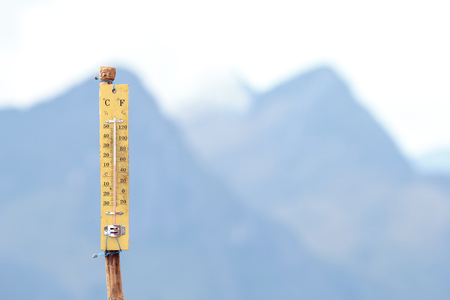 termometer: Thermometer on the top of mountain with 12 degree celsius. Stock Photo