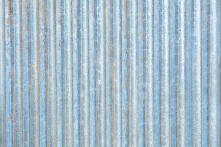 Rusty zinc corrugated iron metal siding for vintage background textured. Stock Photo