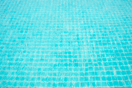 Abstract image surface of blue swimming pool water for background textured usage.