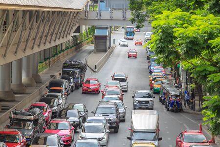 Bangkok, Thailand. - May 21, 2016 : Traffic jam at road in the city center. near interchange skywalk to transit between Sky Transit (BTS) and Bus Rapid Transit (BRT) at Chong Nonsi, Bangkok, Thailand.