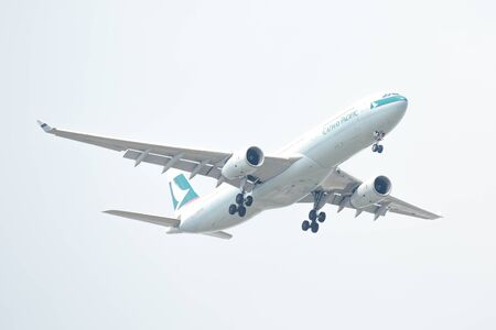 Bangkok, Thailand. - April 22, 2017 : Plane of Cathay Pacific Airlines or Airways on the sky landing to suvarnabhumi airport.