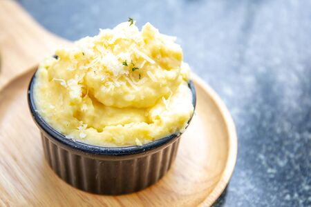 Closeup to Mashed potato in black bowl. with copy space.