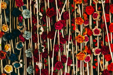 Hanging colorful paper flowers for background.