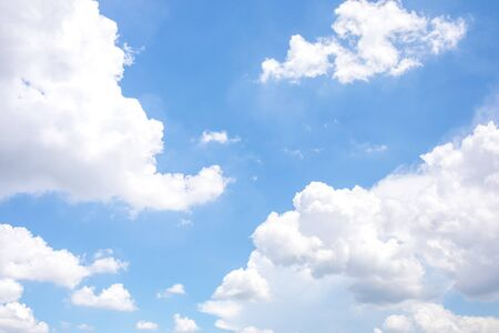 White clouds on the blue sky for background.