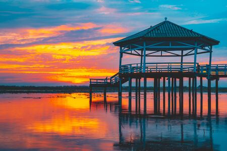 Sunset at the Pavilion on lake or pond or swamp of Bueng See Fai, Phichit, Thailand.