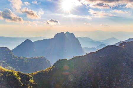 Mountain with Sunset or evening time with blue sky and sunray or sunbeam with clouds at Doi Luang Chiang Dao, Chaingmai, Thailand. Asia. Archivio Fotografico
