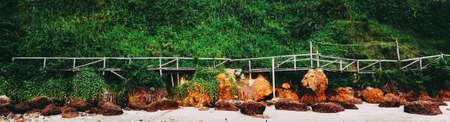 Wooden old bridge along the sea beach. Archivio Fotografico