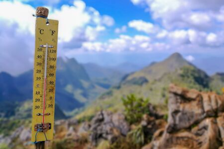 Thermometer on the top of mountain with 13 degree celsius.