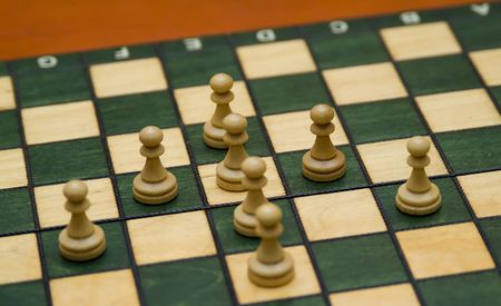 artifice: chess pieces forming an arrow focus on center