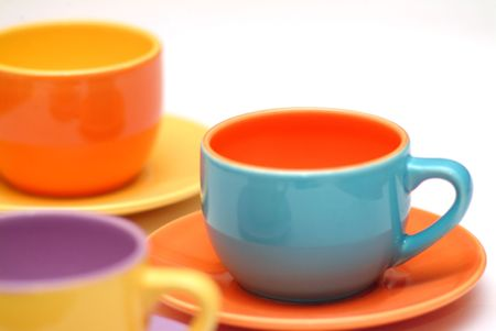 colored tea cups isolated on white background Stock Photo