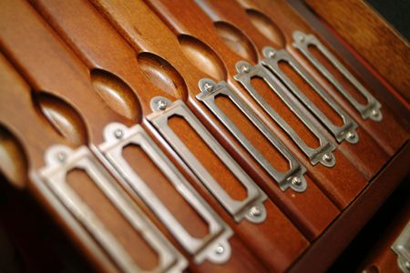 wood file cabinet with focus on center photo