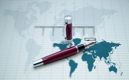 calc: red old pen over a world map and a calc sheet Stock Photo