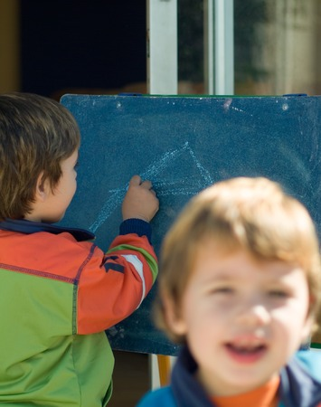 boys painting on a blackboard photo