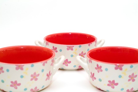 slurp: modern colourfull red soup cups with flowers, focus on far cup