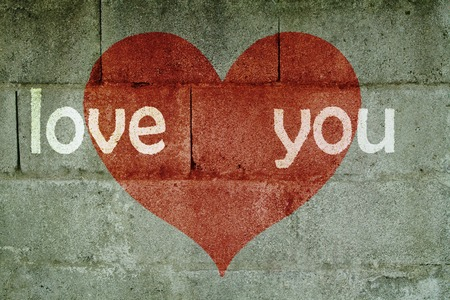 inscription on wall I love you with red heart and white-green old wall Stock Photo
