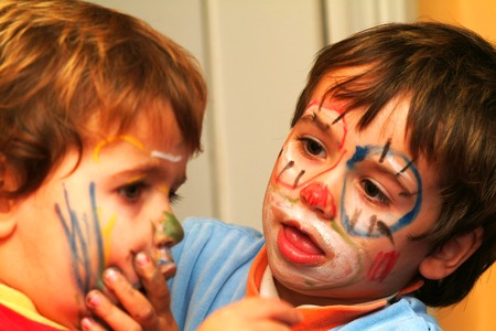two boys painting his faces