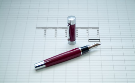calc: red pen over a calc sheet from January to June Stock Photo