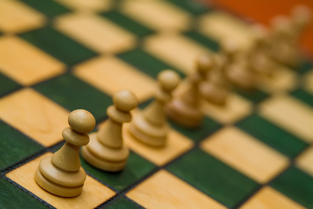 maneuvering: line of chess pieces forming a diagonal
