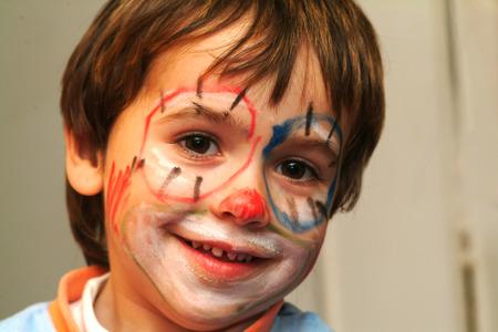 cara pintada: peque�o muchacho con la cara pintada Foto de archivo