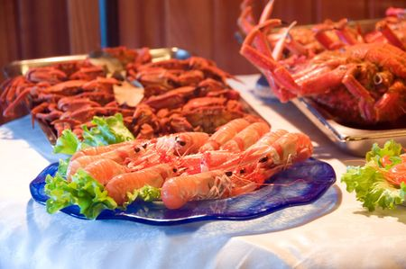 fresh seafood over trays with vegetables, ready to cook photo