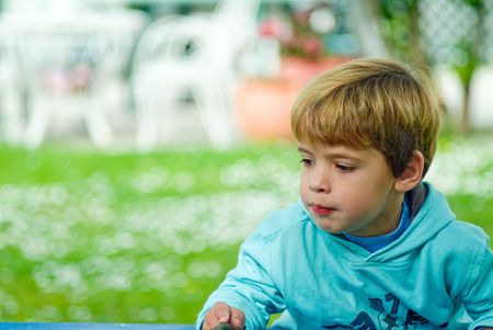 boy playing funny face in the garden