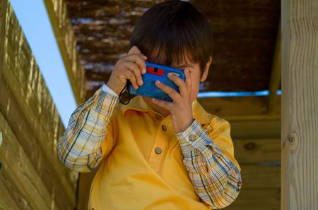 boy playing and taking a photo Stock Photo